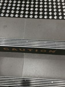 Aluminium stair nosing with multiple black carborundum inserts