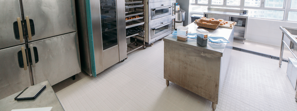 Image of a tiled floor at commercial kitchen gripACTion.com.au
