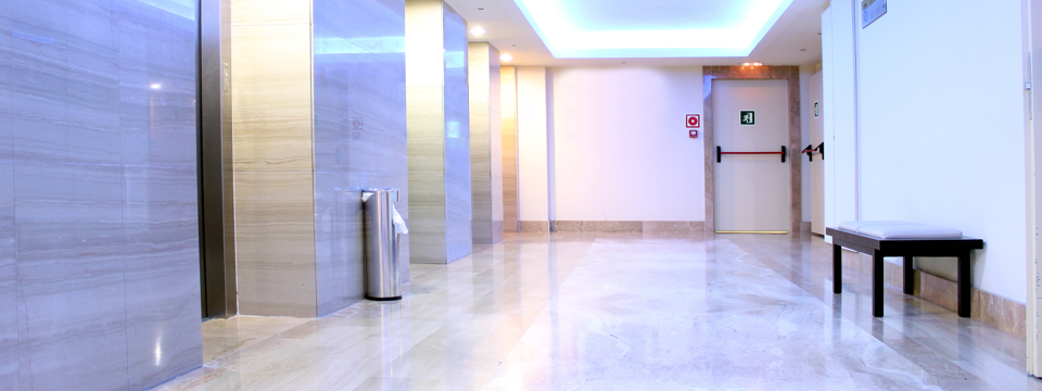 Image of a tiled lift lobby area where you can use gripACTion non slip products - gripACTion.com.au